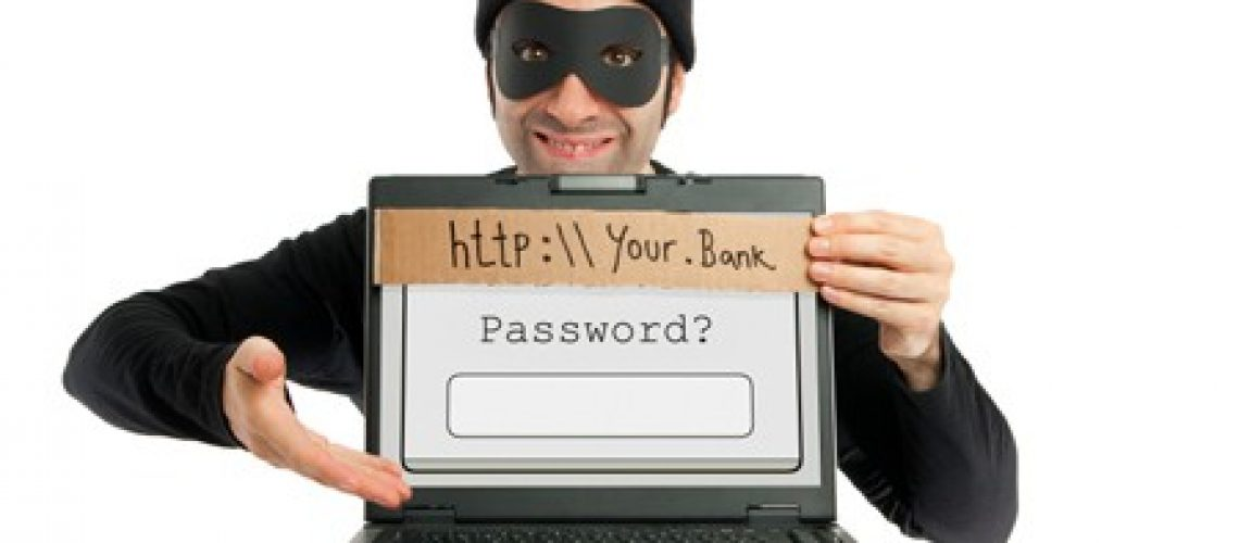 A thief (dressed in black and eye-masked) pops up from behind a laptop's screen and hides the real URL by planting a fake one on it, clumsily written on a piece of cardboard as a visual metaphore for the phishing technique. Then, he